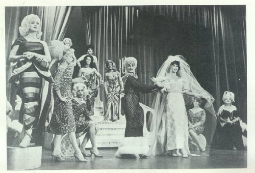 "The Jewel Box Revue was a famous drag/female impersonator touring company that began in 1939 and ran well into the 1960s. Danny Brown and Doc Benner were lovers and longtime producers of the revue, and were said to be pretty tough customers who never backed down from a fight and were known to run a very tight ship. They were hard on their employees but could be brutal to anyone who messed with ""their girls."" The show became incredibly popular throughout the United States. Stars of the revue such as Mr. Lynne Carter, whose talent and skill as a dancer was legendary, became quite famous and included the Rat Packer and toe-tapper Sammy Davis Jr. as a fan. The drag revue was most often comprised of ""25 Men & One Girl."" The one girl was none other than Miss Storme DeLaviere who served as the sole male impersonator for the revue. Storme would garner iconic status within the LGBT community in 1969 for being one of the first people to fight back against police officers during the raid on the Stonewall Inn. The riots that followed would spark the modern gay-rights movement. Despite government crackdowns against gay performers and female impersonators, the revue successfully toured America and Canada for nearly 30 years. At the height of its popularity the revue headlined at the famed Apollo Theater in Harlem to rave reviews. (Jewel Box Revue photos via QueerMusicHeritage. Click on photo to begin slide show.)"