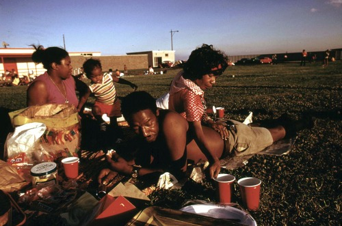 A family enjoys a picnic at 12th Street Beach on Lake Michigan, August 1973.