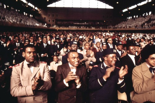 Muslims applaud Elijah Muhammad during the delivery of his Savior's Day Message
