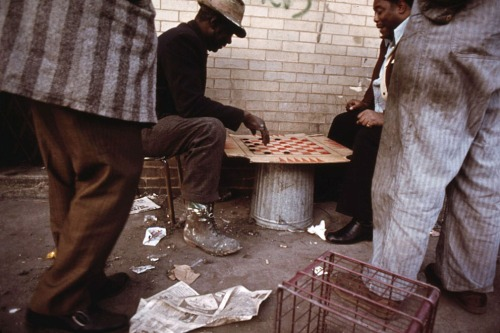 Workers pass the time playing checkers on East 35th Street before going to work in Chicago, May 1973