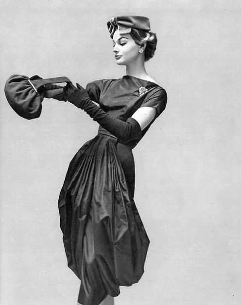 Monique Chevalier is wearing a dress by Grès, hat by Rose Valois, jewellery by Scémam and a handbag by Francis Winter, 1957. Photo by Georges Saad.